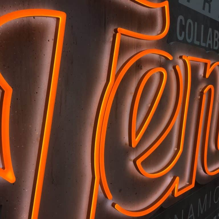 Orange faux neon text sign made with Neonplus illuminated LEDs