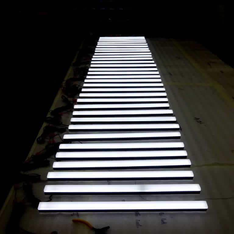 White neon style stripes with black edges for visual merchandising stand