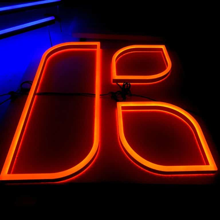 Abstract neon K light for store and shop signmaking. Red faux neon lettering.