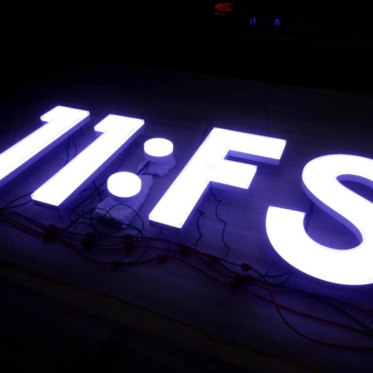11:FS faux neon sign, white LED illuminated lettering.