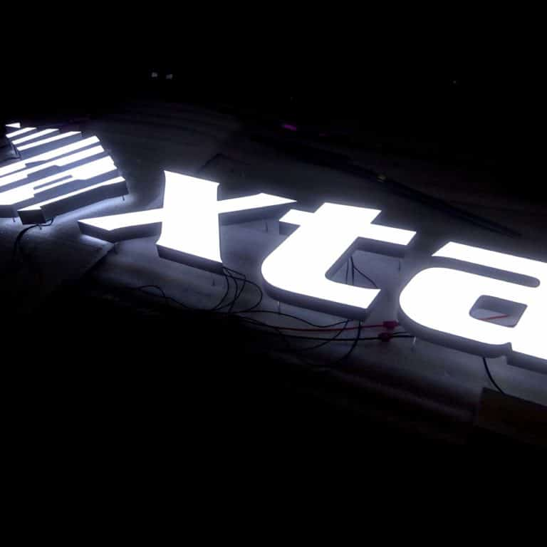 Neon logo signs for outdoor displays and storefronts. XTA neonplus sign using artificial neon.